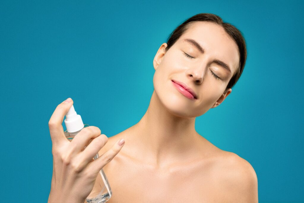 woman applying micellar water