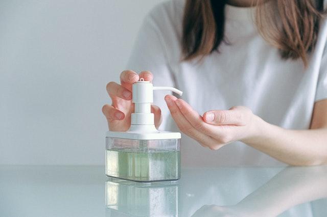girl using sanitizer