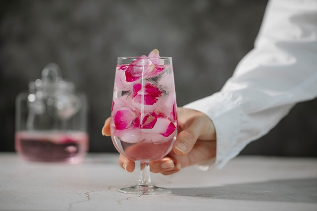 A glass filled with rose water